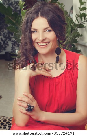Beauty laughing woman indoors. Beautiful adult Model smiling. Happy elegant Woman. Toned in warm colors