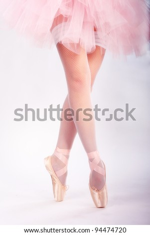 Beauty legs of ballerina standing in pointes - stock photo