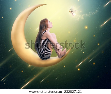 Beauty lonely thoughtful woman sitting on the crescent moon looking up on falling stars. Dreamland imagination screen saver background. Face expression, emotion, life perception  - stock photo