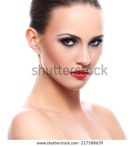 Beauty, make-up. Attractive girl with serious face - stock photo
