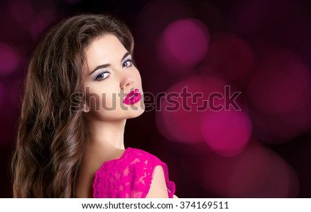 Beauty Makeup Woman face Portrait. Beautiful girl model with sensual lips posing isolated on dark bokeh lights holiday background. - stock photo