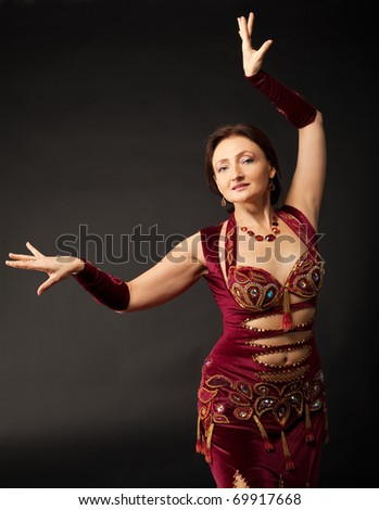 Beauty mature woman dance in arabic costume