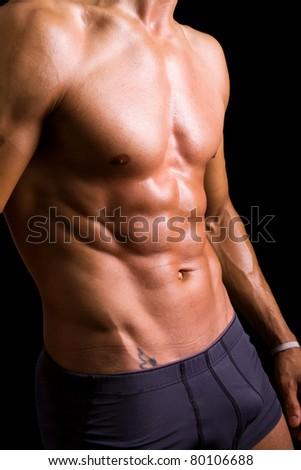 Beauty men torso. Naked body. Isolated on black. - stock photo