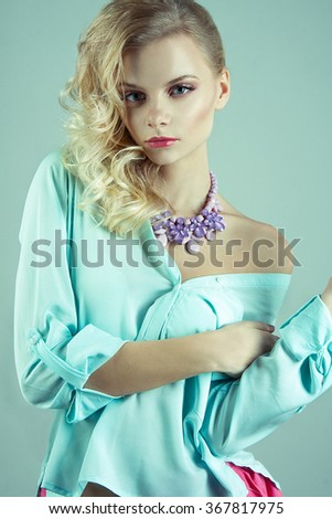 Beauty mint girl with accessories. Styled hair - stock photo