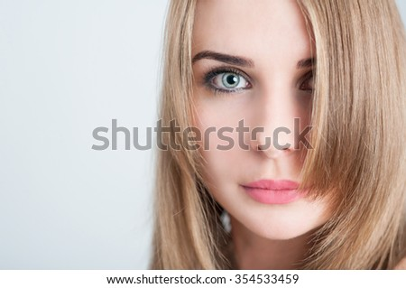 Beauty model face closeup on gray background - stock photo