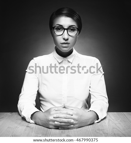 Beauty model girl in glasses. Young Teacher brunette woman in studio on gray background