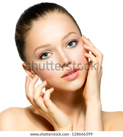 Beauty Model Girl Portrait. Beautiful Woman Face. Looking at Camera. Isolated on White Background. Pretty Girl Touching her Face - stock photo