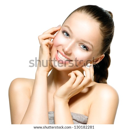 Beauty Model Girl Portrait . Beautiful Woman Face. Looking at Camera. Isolated on White Background. Pretty Girl Touching her Face. Smiling, Laughing, Happy Teenage Girl - stock photo