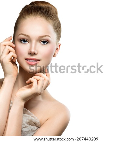 Beauty Model Girl Portrait . Beautiful Woman Face. Looking at Camera. Isolated on White Background. Pretty Girl Touching her Face  - stock photo