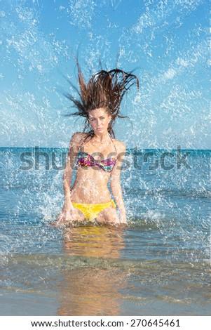 Beauty Model Girl Splashing Water in the ocean. Beautiful Woman in Water - stock photo