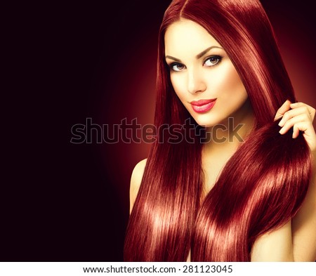 Beauty Model girl with Healthy Brown Hair. Beautiful brunette woman touching her long smooth shiny straight hair. Hairstyle. Hair cosmetics, haircare. Hair care, extensions. Over black background - stock photo