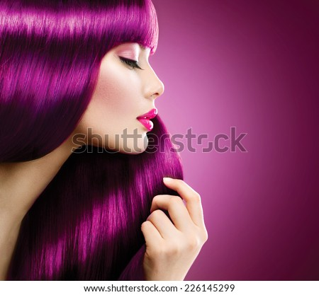 Beauty Model girl with Healthy Purple coloured Hair. Beautiful woman takes her  long smooth pink shiny straight hair. Hairstyle. Hair cosmetics, haircare  - stock photo