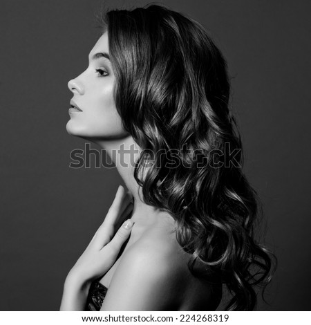 Beauty Model Girl with Long Healthy Wavy Hair and Perfect Makeup. Beautiful Woman with Shiny Hair. Black and white.