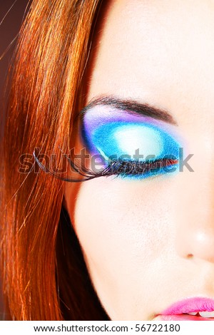 Beauty model with color makeup - stock photo