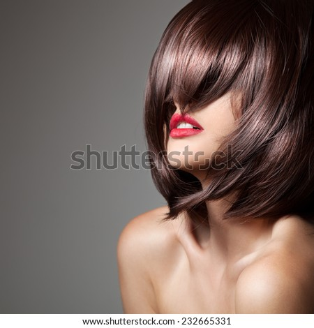 Beauty model with perfect long glossy brown hair. Close-up portrait. - stock photo