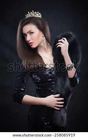 Beauty model woman wearing fur coat, diamond crown - stock photo
