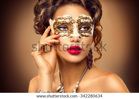 Beauty Model Woman Wearing Venetian Masquerade Carnival Mask At Party Over Holiday Background Christmas