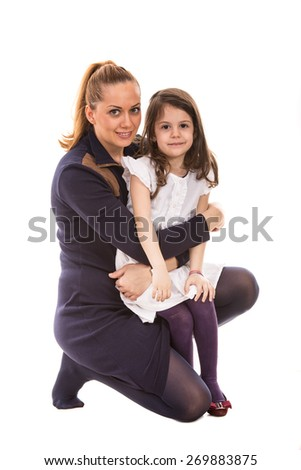 Beauty mother posing with her daughter isolated on white background - stock photo