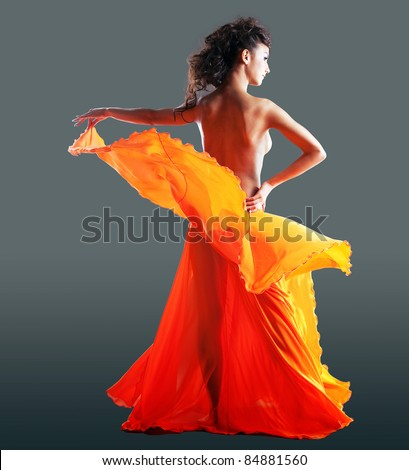 beauty naked woman dance in orange veil - stock photo