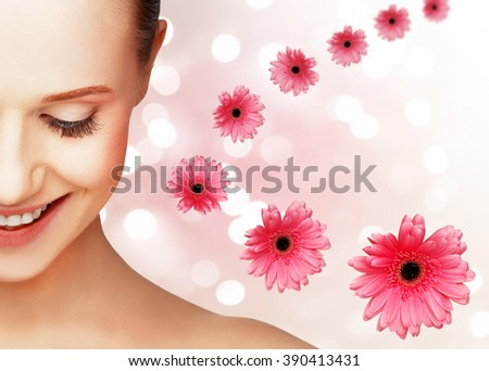 beauty natural portrait of a young girl with a flower pink gerbera - stock photo