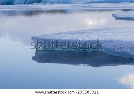 Beauty of breaking Ice in Jokulsarlon with water reflection - stock photo
