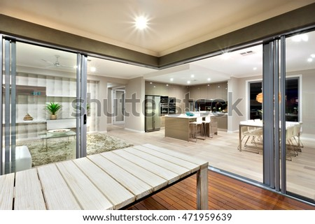 Beauty of interior lighting can be seen through this place. Living room, kitchen and dinning area at the same place in the mansion. The whole house has a wooden floor and illuminated using lights.