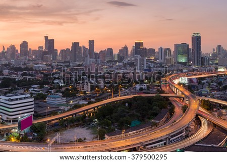 Beauty of sky after sunset over intersection highway with city downtown background - stock photo