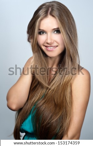 Beauty of young woman with  long straight hair. Long hair