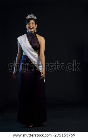Beauty pageant walking down the ramp - stock photo