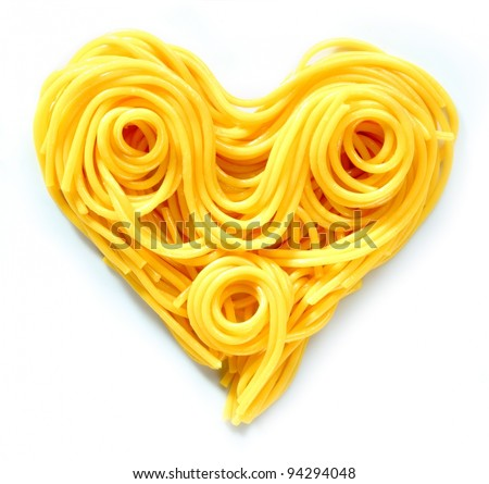 Beauty Pasta Heart. Heart-shaped arrangement of pasta, or spaghetti, isolated on white, concepetual of love and romance. - stock photo