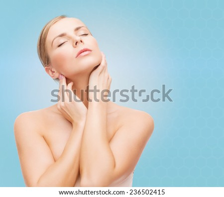 beauty, people and health concept - beautiful young woman with closed eye touching her neck over blue background - stock photo