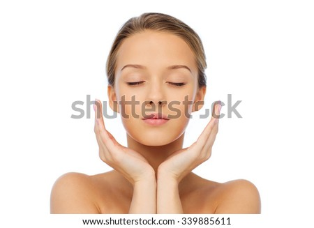 beauty, people, skincare and health concept - young woman face and hands - stock photo