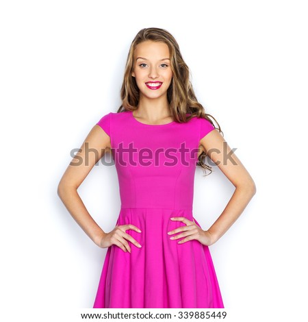 beauty, people, style, holidays and fashion concept - happy young woman or teen girl in pink dress - stock photo