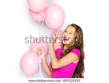 beauty, people, style, holidays and fashion concept - happy young woman or teen girl in pink dress with helium air balloons - stock photo