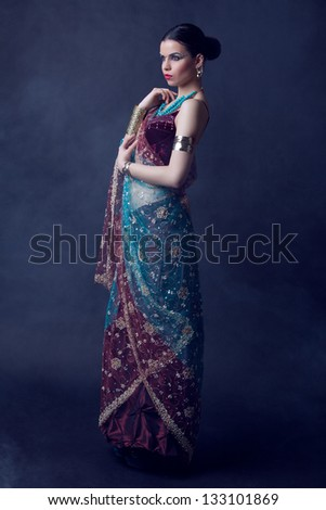 Beauty photo of a young indian woman in traditional clothing - stock photo
