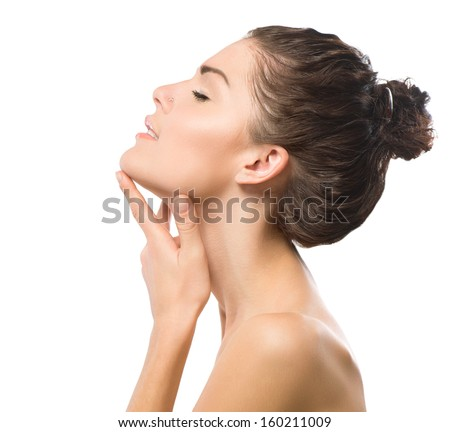 Beauty Portrait. Beautiful Spa Girl Touching her Face. Perfect Fresh Skin. Pure Beauty Model Girl. Youth and Skin Care Concept. Beauty Teenage Model Girl Portrait - stock photo