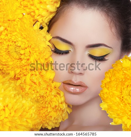 Beauty Portrait. Beautiful Spa Woman over yellow flowers. Eyes. Perfect Fresh Skin. Pure Beauty Model Girl. Beautiful Face. Youth and Skin Care Concept - stock photo