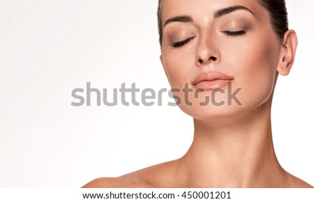 Beauty Portrait. Beautiful Spa Woman. Perfect Fresh Skin. Youth and Skin Care Concept. Studio shot. Isolated on white background - stock photo