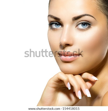 Beauty Portrait. Beautiful Spa Woman Touching her Face. Perfect Fresh Skin closeup. Isolated on White Background. Pure Beauty Model. Youth and Skin Care Concept  - stock photo