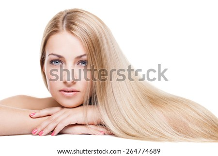 Beauty Portrait. Beautiful young woman with long blond silky hair isolated over white background. - stock photo