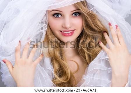 Beauty portrait. Fashion photo of beautiful women under white veil. - stock photo