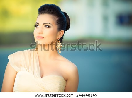 Beauty portrait of a beautiful elegant woman outside.Perfect fresh skin.Pure beauty model girl.Beautiful sexy woman in flirty elegant dress outfit.Brunette bride woman with formal updo.Prom girl. - stock photo