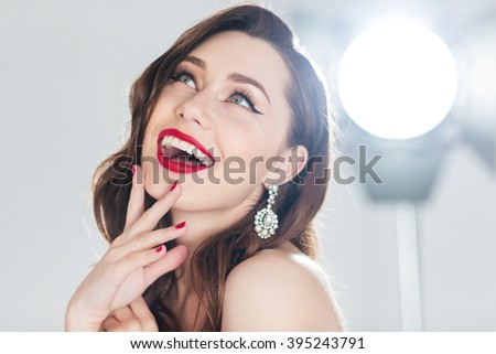 Beauty portrait of a cheerful woman looking up - stock photo