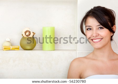 Beauty portrait of a female smiling at a bathroom - stock photo