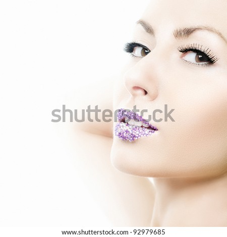 Beauty portrait of a girl with crystal lips