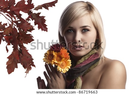 beauty portrait of a natural looking blonde with flowers in her hand - stock photo