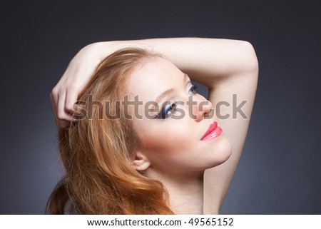 Beauty portrait of a sensitive red-haired woman