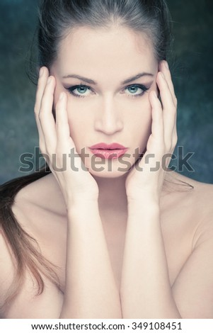 beauty portrait of a young blue eyes woman, studio shot, front view - stock photo