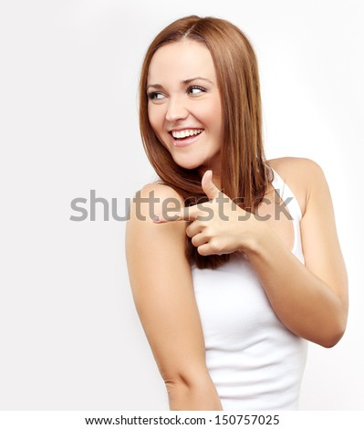 Beauty portrait of a young brunette woman pointing with her index fingers at copy space. - stock photo