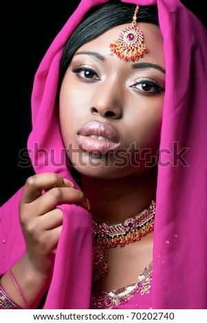 Beauty portrait of a young indian woman, closeup shot - stock photo
